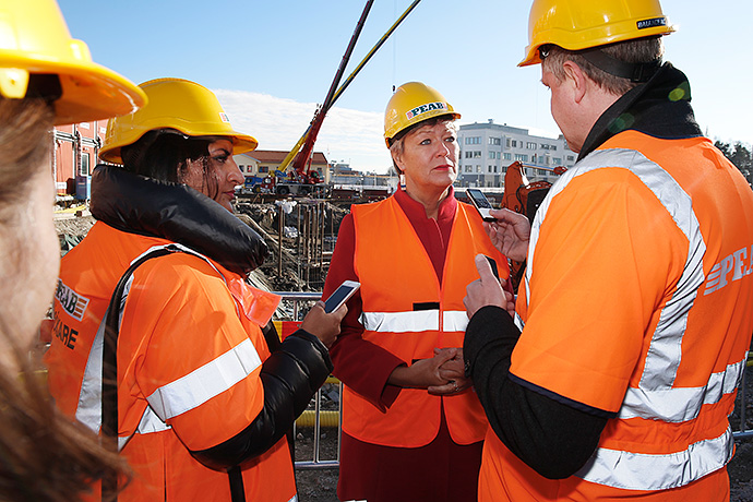 Ylva Johansson during an interview in front of a construction site.