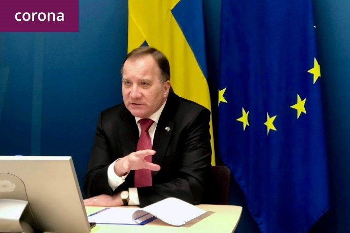 Swedish Prime Minister Stefan Löfven participating at the video conference sitting in front of a screen.