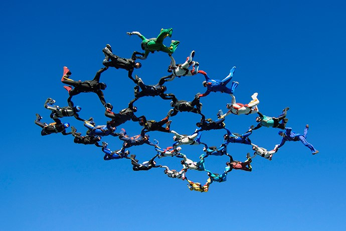 Photo of people in the air constructing a pattern.