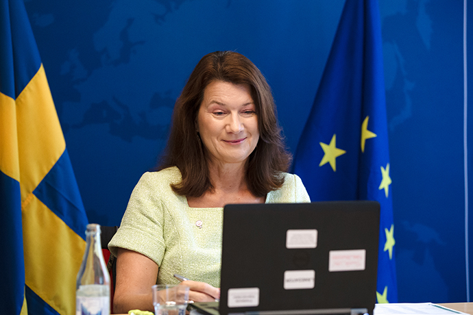 Minister for Foreign Affairs Ann Linde during the meeting. She is sitting by a table and looking into a computer.