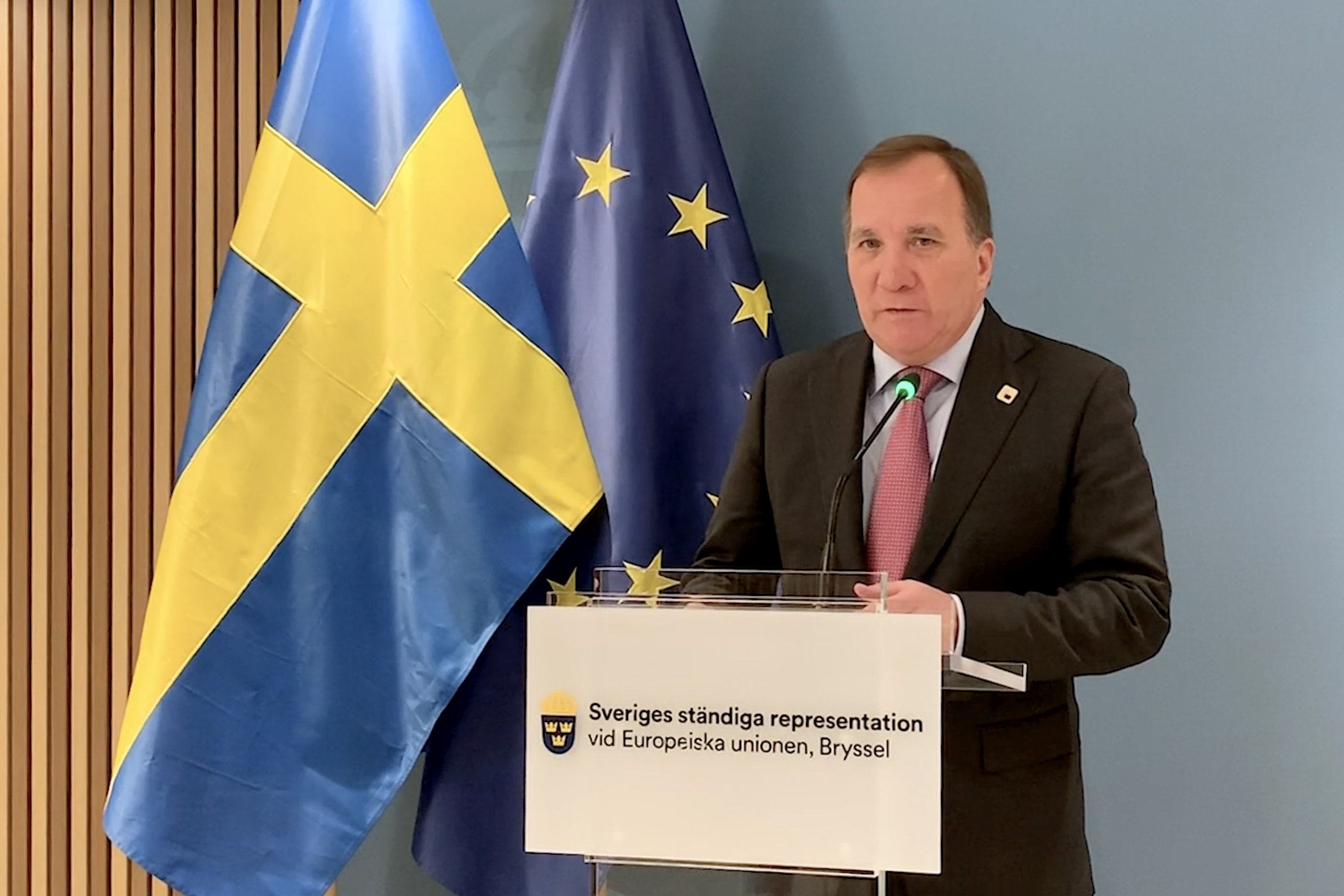 Swedish Prime Minister Stefan Löfven is speaking to journalists at a press conference.