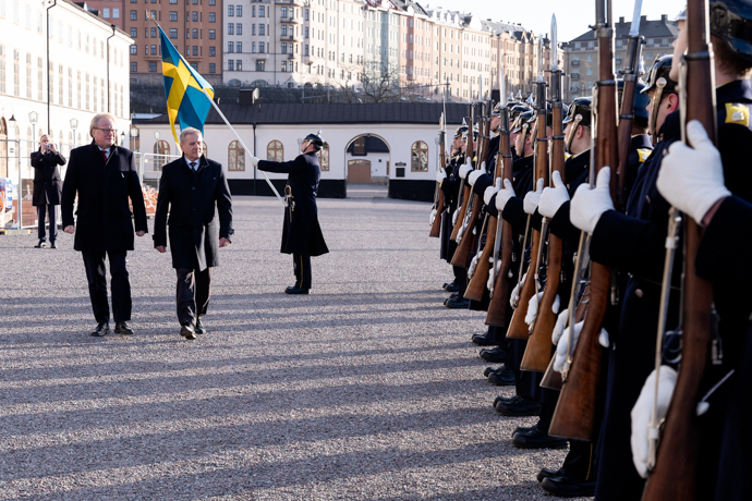 Peter Hultqvist and Tibor Benkö inspect the guard of honour at Karlberg Palace.