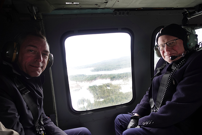 Norway's Minister of Defence Frank Bakke-Jensen and Minister for Defence Peter Hultqvist inside a helicopter.