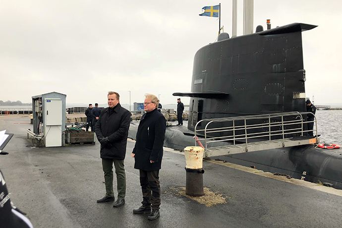 The ministers in front of one of the Swedish Navy's submarines.