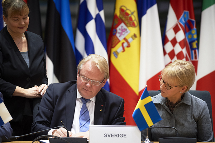 Swedish Minister for Defence Peter Hultqvist and Swedish Minister for Foreign Affairs Margot Wallström during the signing ceremony.