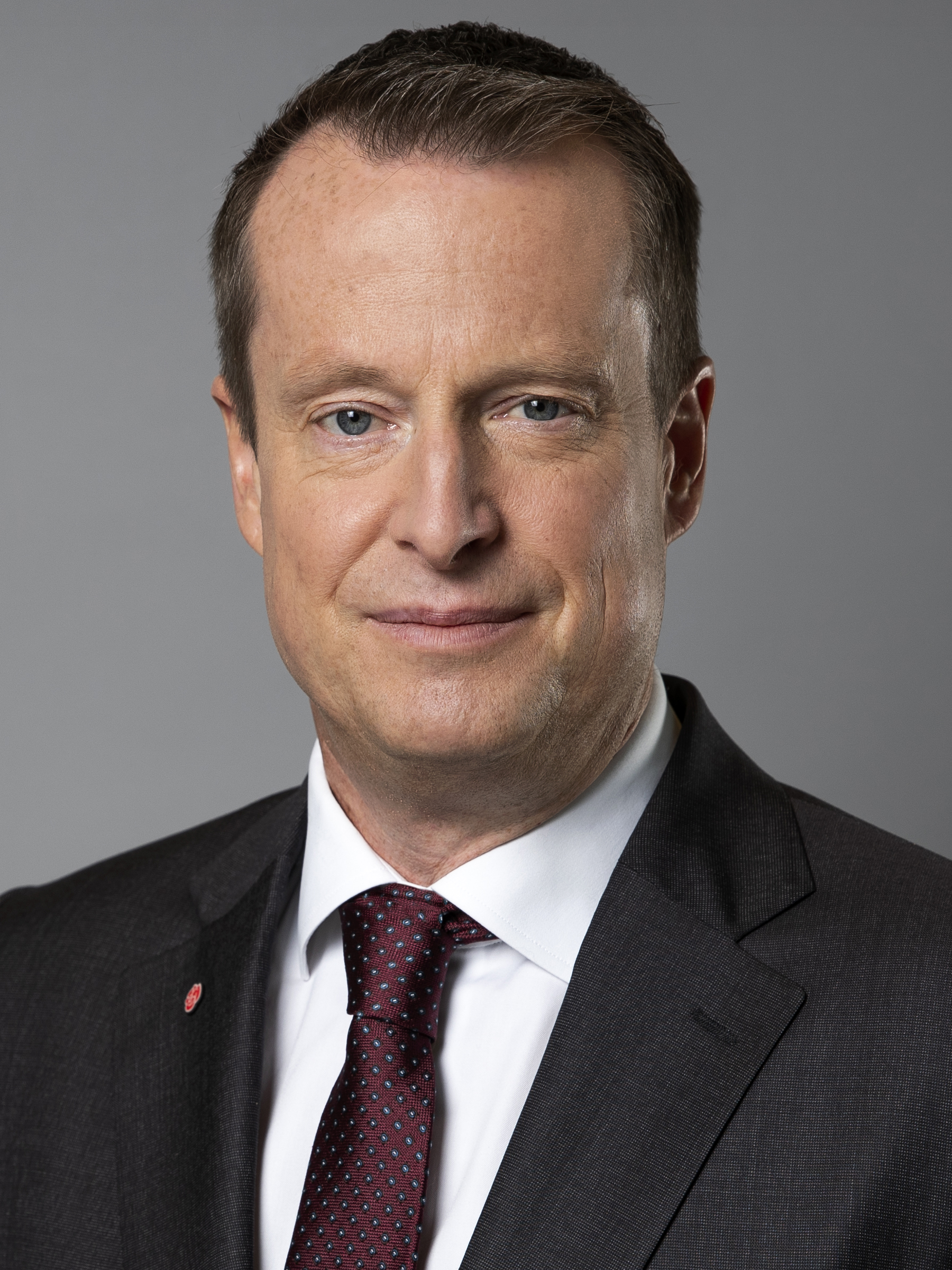 Minister for Energy and Digital Development's portrait.