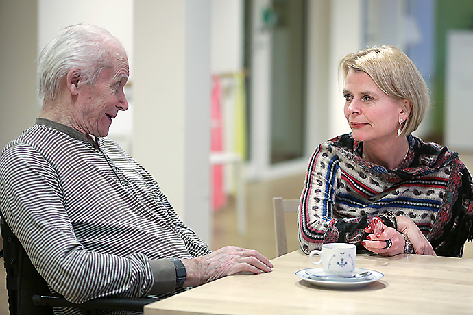 Woman and elderly man having a conversation
