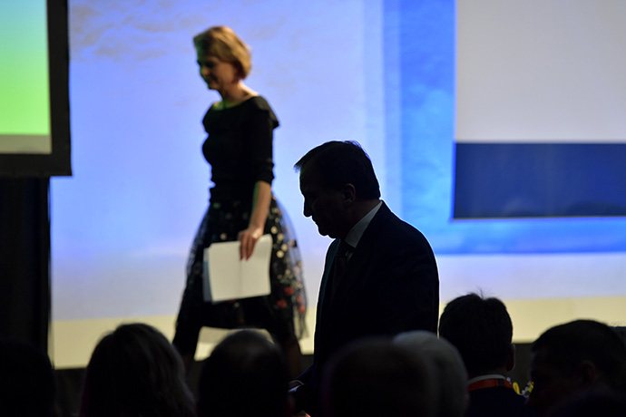 Åsa Regnér, Minister for Children, the Elderly and Gender Equality and Stefan Löfven, Prime Minister, Government of Sweden. The Prime Minster is seen as a shadow as he stands in the audience.