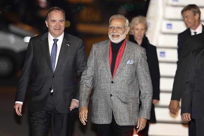 Prime Minister Stefan Löfven receives India's Prime Minister Narendra Modi at Arlanda Airport.